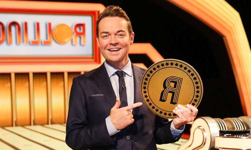 Stephen Mulhern wearing a suit and tie: Hello! Magazine