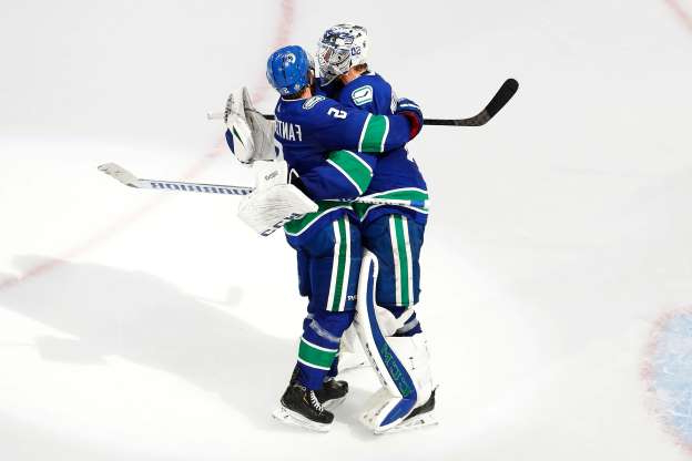 Slide 1 of 49: Aug. 21: Vancouver Canucks goaltender Jacob Markstrom and defenseman Oscar Fantenberg celebrate the team's series-winning Game 6 victory against the St. Louis Blues.