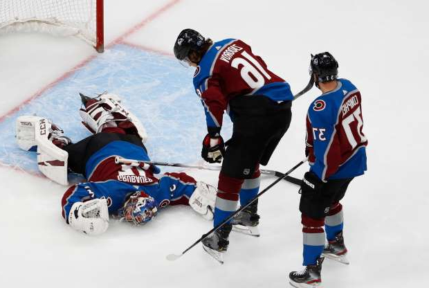 Slide 1 of 50: Aug. 22: The Colorado Avalanche's Nikita Zadorov and J.T. Compher check on goaltender Philipp Grubauer after he suffered an injury during Game 1 against the Dallas Stars.