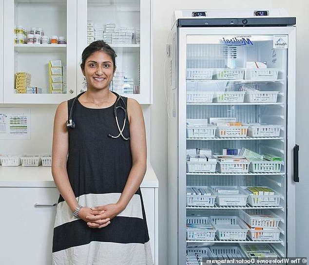 a person standing in front of a refrigerator: Dr Preeya Alexander (pictured) has shared what she's eating every week while in lockdown and her typical exercise regime