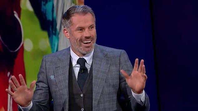 Jamie Carragher wearing a suit and tie: Jamie Carragher has hilariously pretended to translate Robert Lewandowski's interview