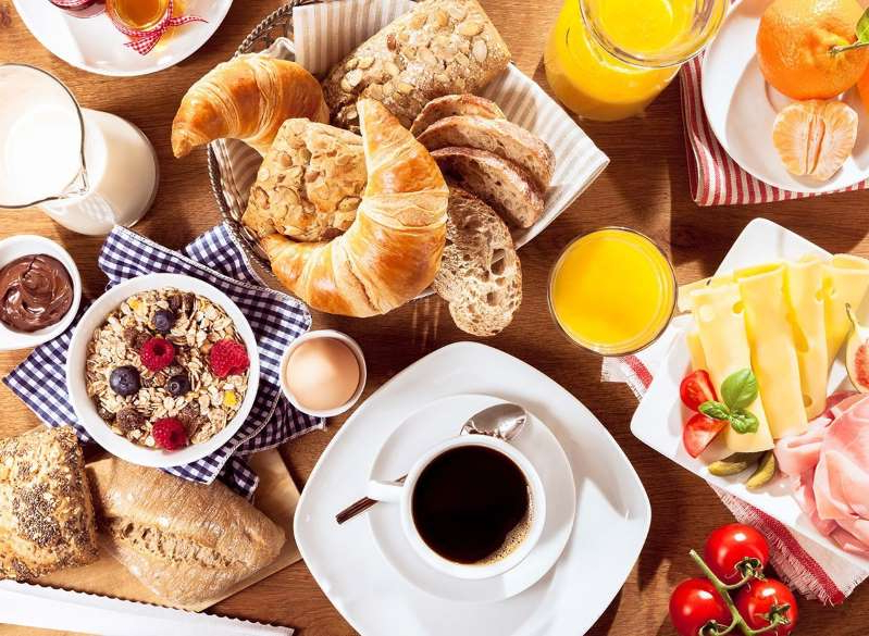a table topped with plates of food on a plate: breakfast foods