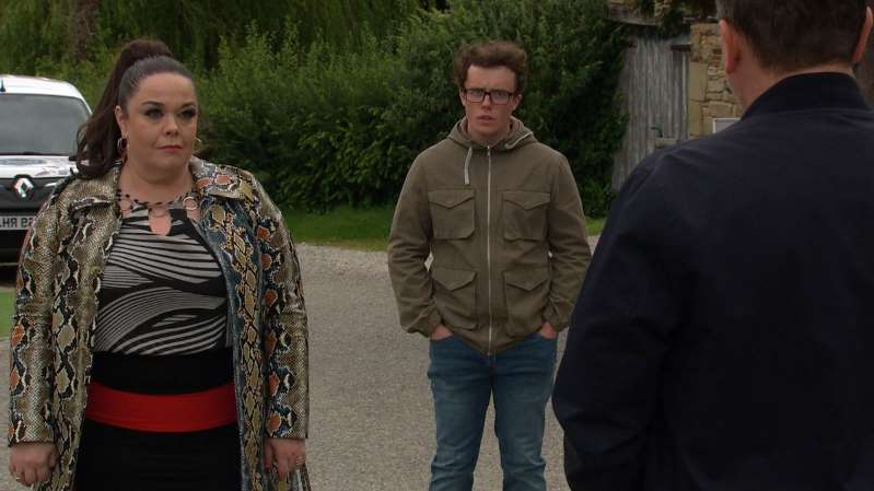 Lisa Riley standing next to a woman: Paul Ashdale, Vinny Dingle and Mandy Dingle in Emmerdale