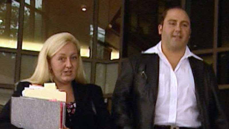 a group of people posing for the camera: Nicola Gobbo represented Tony Mokbel in court. (ABC News)