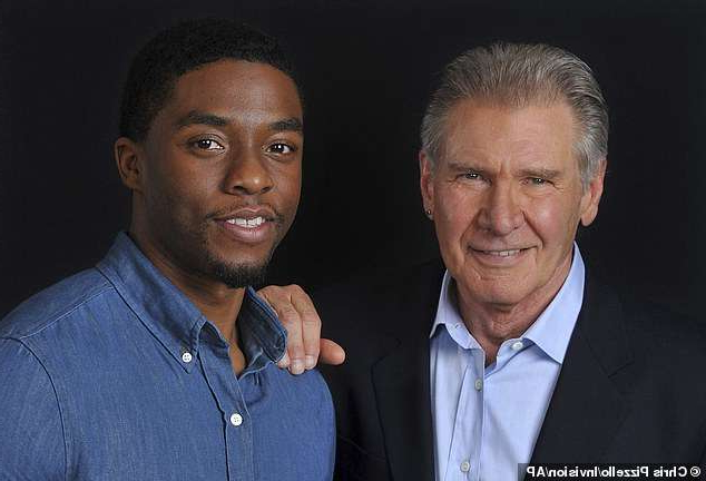 Harrison Ford, Chadwick Boseman posing for the camera: Remembering a costar: Harrison Ford is most recent Hollywood actor to honor the late Chadwick Boseman, whose death on Friday at age 43 shocked the industry; seen in 2013