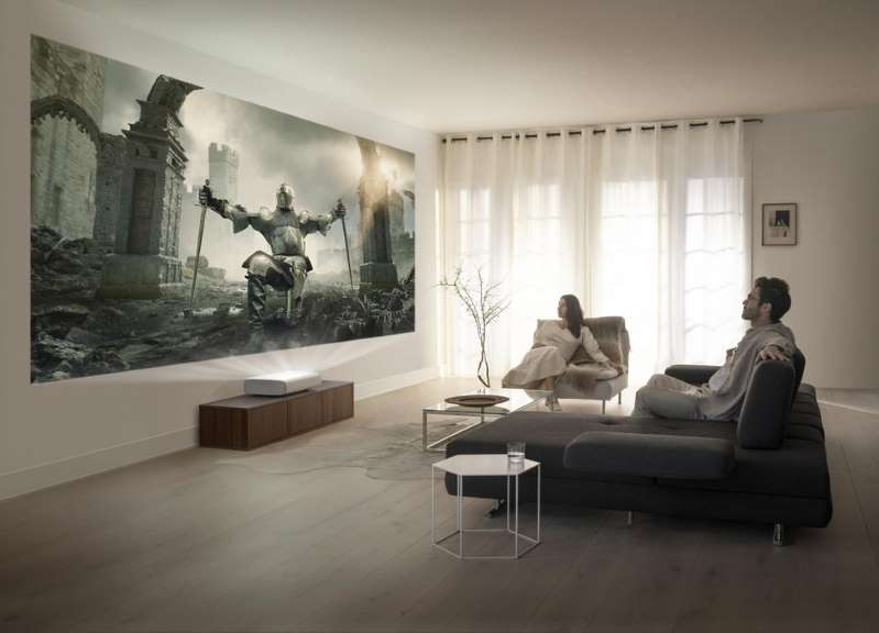 a living room filled with furniture and a large window: Samsung