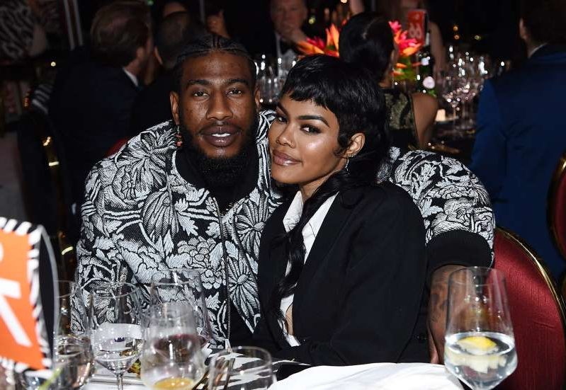 Teyana Taylor, Iman Shumpert sitting at a table with wine glasses: Jamie McCarthy/Getty Images Teyana Taylor and Iman Shumpert