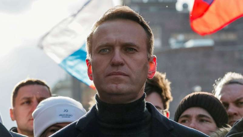 Alexei Navalny looking at the camera: FILE Russian opposition politician Alexei Navalny takes part in a rally to mark the 5th anniversary of opposition politician Boris Nemtsov's murder and to protest against proposed amendments to the country's constitution.