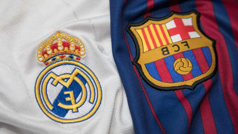 a blue and white shirt: La Liga live stream: watch Real Madrid and Barcelona online for free
