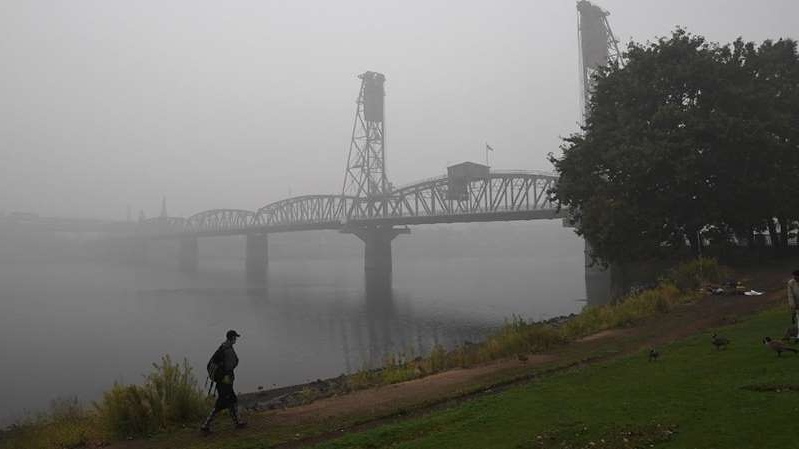 a bridge over a body of water: Experts warn wildfire smoke could worsen COVID-19