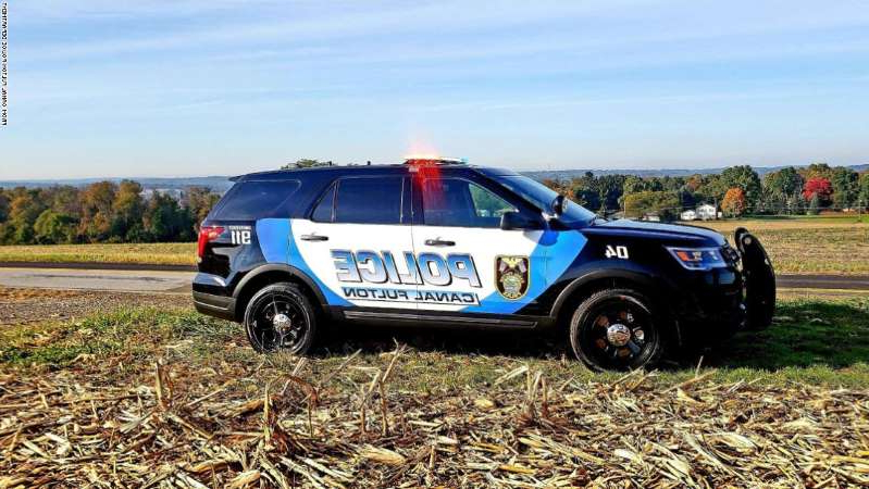 a car parked in a field: A White police chief in Ohio laid out why BLM protests matter in small towns.