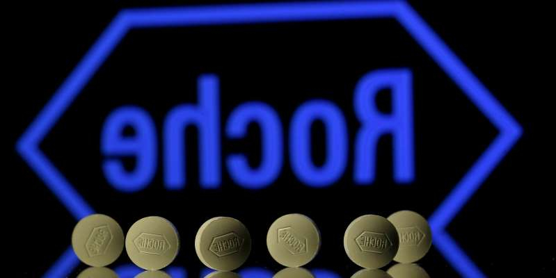 a close up of a light: Roche tablets are seen positioned in front of a displayed Roche logo in this photo illustration. Reuters