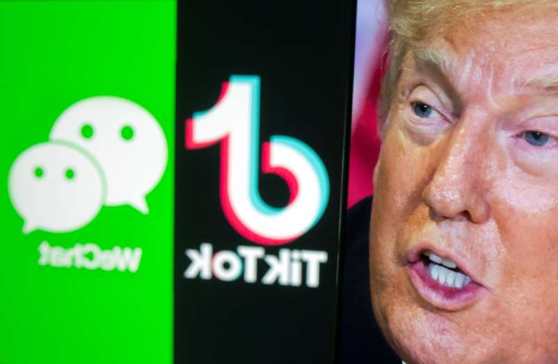 a close up of a man making a face for the camera: A picture of U.S. President Donald Trump is seen on a smartphone in front of displayed Tik Tok and WeChat logos in this illustration
