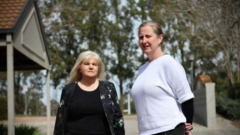 a man standing next to a woman: Residents Leesa Mountford and Kerry Hall will seek legal advice over the petrol spill. (ABC News: Selby Stewart)