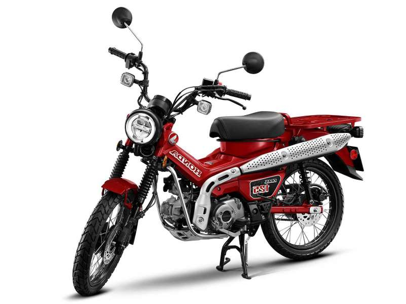 a motorcycle parked on the side: The Honda Trail 125 ABS is going to be pure fun on two wheels.