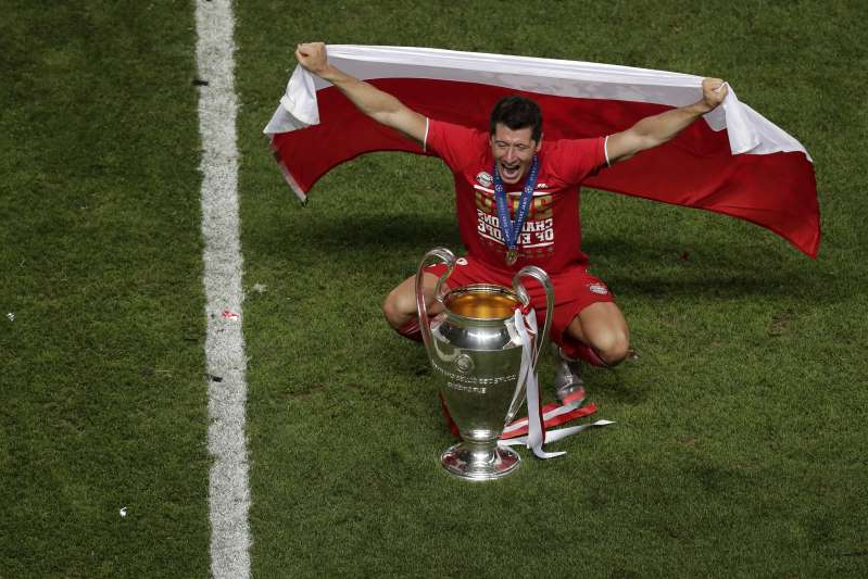 Bayern's Robert Lewandowski celebrates with the trophy after the Champions League final soccer match between Paris Saint-Germain and Bayern Munich at the Luz stadium in Lisbon, Portugal, Sunday, Aug. 23, 2020. (AP Photo/Manu Fernandez, Pool)