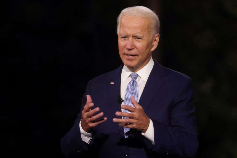 Joe Biden wearing a suit and tie: Democratic U.S. presidential nominee Biden takes part in an outdoor town hall meeting with CNN in Scranton, Pennsylvania