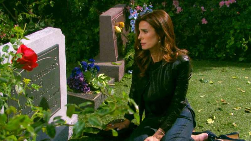 Kristian Alfonso sitting on the grass: Days Of Our Lives