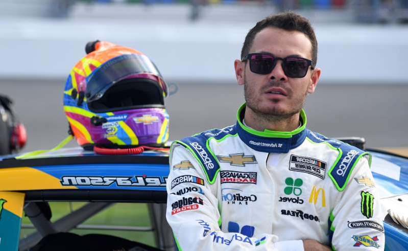 Kyle Larson riding on the back of a motorcycle: NASCAR Cup Series driver Kyle Larson is currently suspended.
