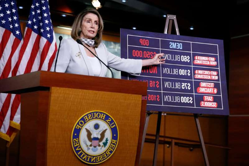 Nancy Pelosi holding a sign: House Speaker Nancy Pelosi of Calif., speaks during a news conference on Capitol Hill in Washington, Thursday, Aug. 13, 2020.