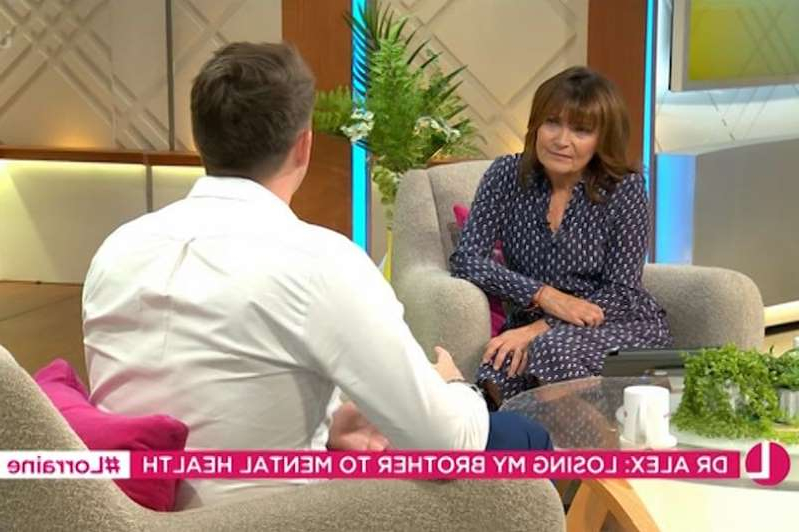 a man and a woman sitting at a table: Lorraine Kelly talking to Dr Alex George