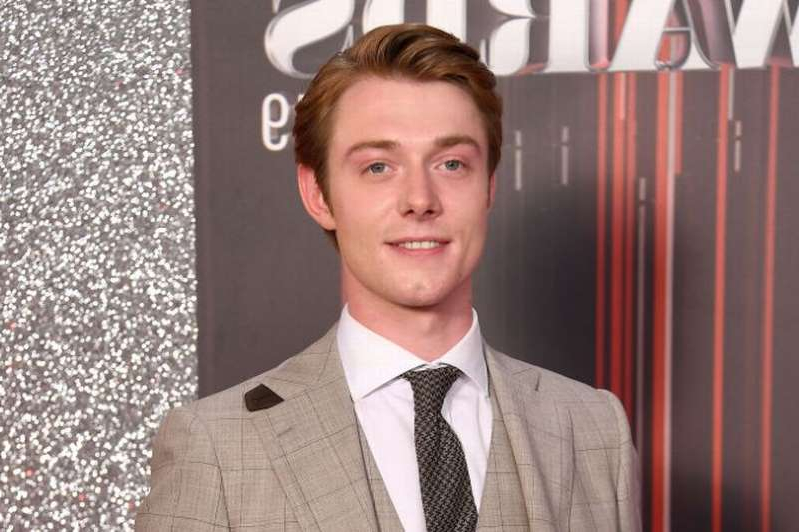 a man wearing a suit and tie smiling at the camera: Rob Mallard first joined Coronation Street as Ken Barlow's son in 2016