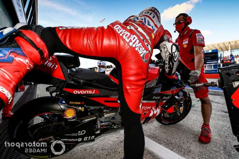 a person riding on the back of a motorcycle: Andrea Dovizioso, Ducati Team