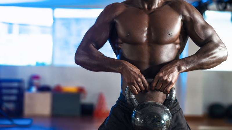 a person wearing a costume: 3-move kettlebell workout for big arms