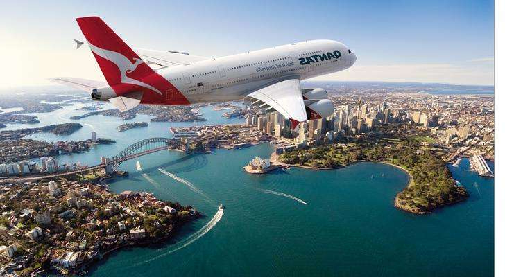 a plane in the water: Qantas Airbus 380 jet over Sydney Harbor