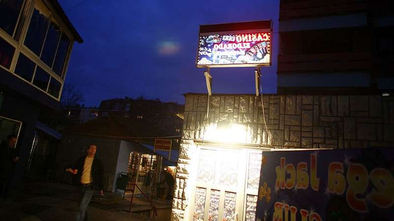 a store front at night: Kosovo banned all gambling last year in a crackdown on organised crime