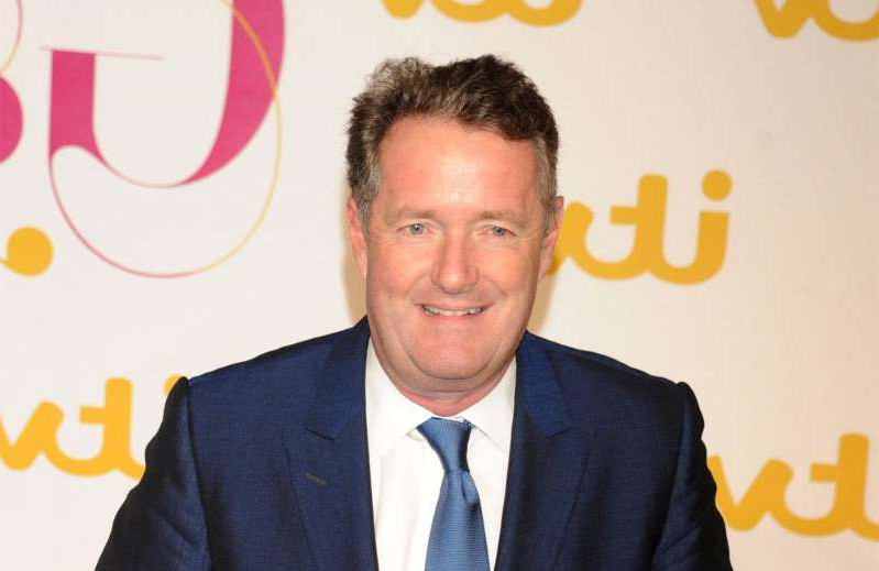 Piers Morgan wearing a suit and tie