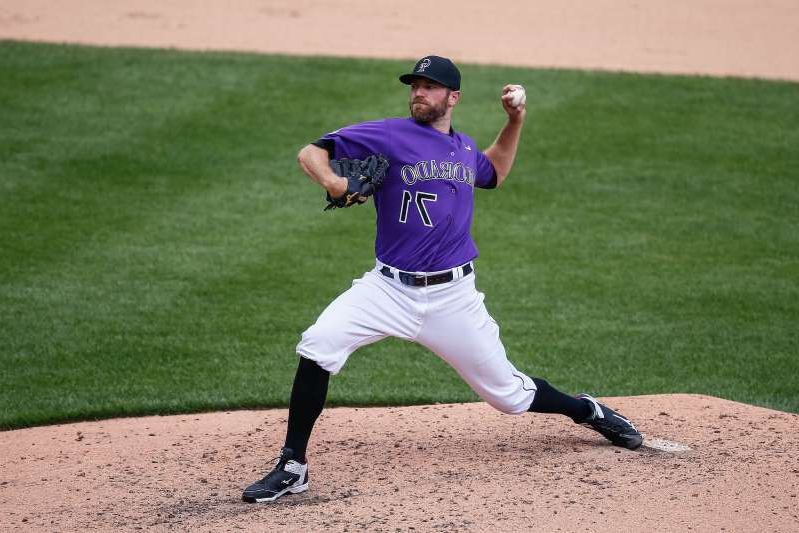 a baseball player throwing a ball: Colorado Rockies relief pitcher Wade Davis has been DFA'd.