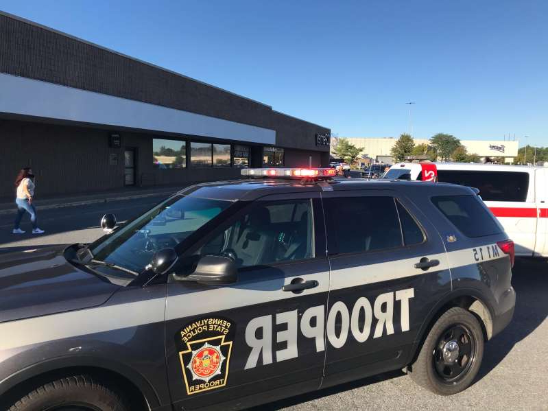 a car parked in a parking lot: Pennsylvania State Police converge on the Lehigh Valley Mall after reports of an active shooter Saturday afternoon, Sept. 19, 2020.
