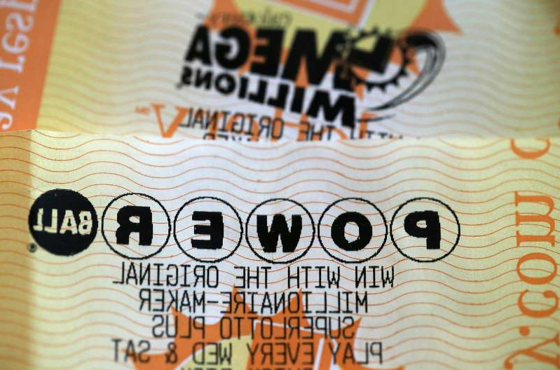 a close up of text on a white surface: Powerball and Mega Millions lottery tickets are displayed on January 3, 2018 in San Anselmo, California.