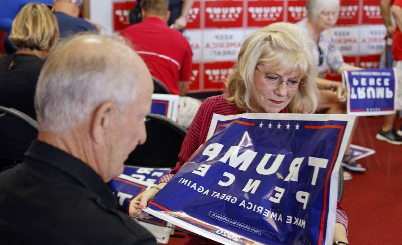 Arlene and Earl Speas assemble Trump Pence yard signs ahead of the opening of the Nebraska Trump Victory Office in Omaha, Neb., Thursday, Aug. 20, 2020. The party has invested heavily in its ground game to help the whole GOP ticket.
