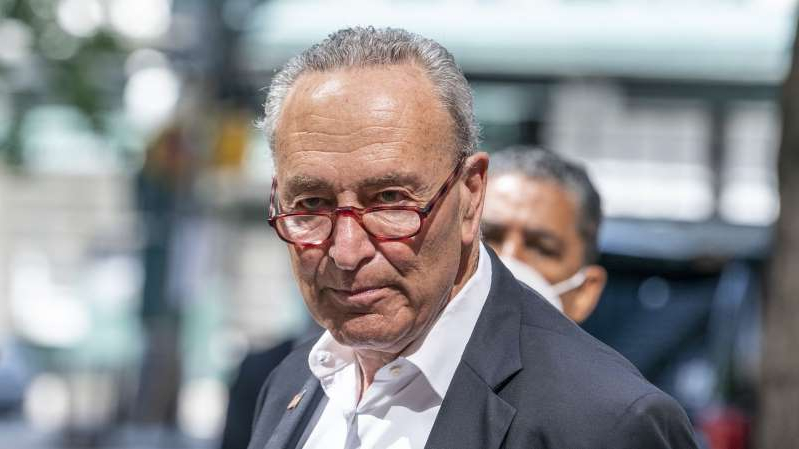 Chuck Schumer wearing a suit and tie: Sen. Chuck Schumer speaks in New York City in September 2020.