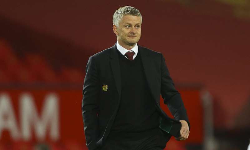 Ole Gunnar Solskjaer wearing a suit and tie: MailOnline logo