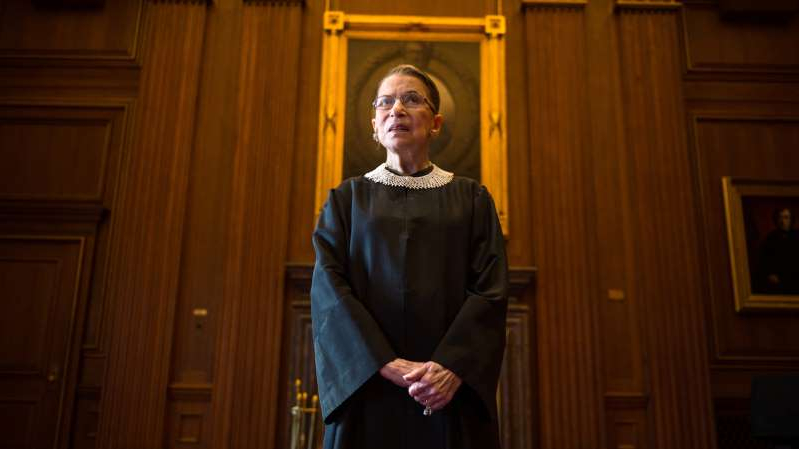 Ruth Bader Ginsburg standing in front of a door