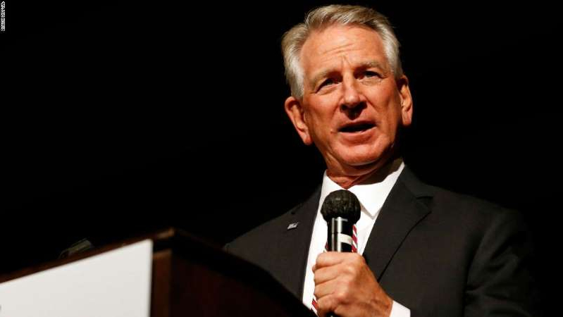 Tommy Tuberville wearing a suit and tie: Former Auburn football coach Tommy Tuberville speaks to supporters after defeating former U.S. Attorney General Jeff Sessions in the runoff election on July 14, 2020, in Montgomery, Alabama. (AP Photo/Butch Dill)