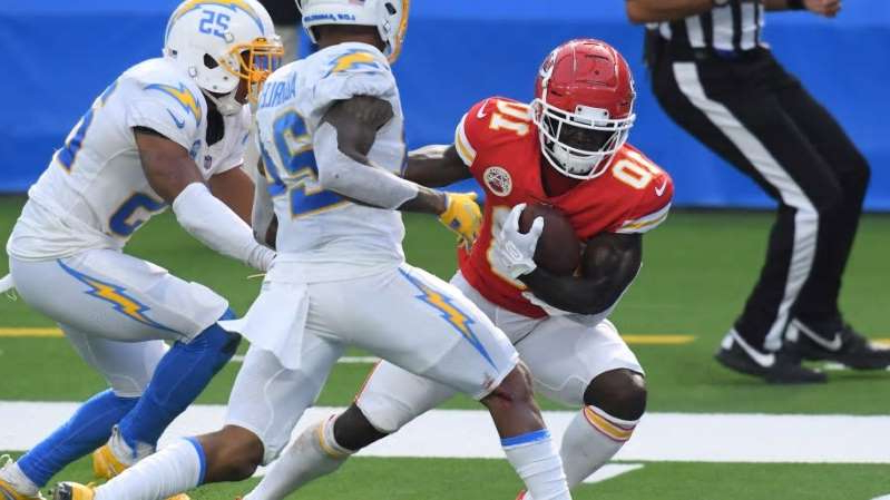 a group of football players on the field: Tyreek Hill