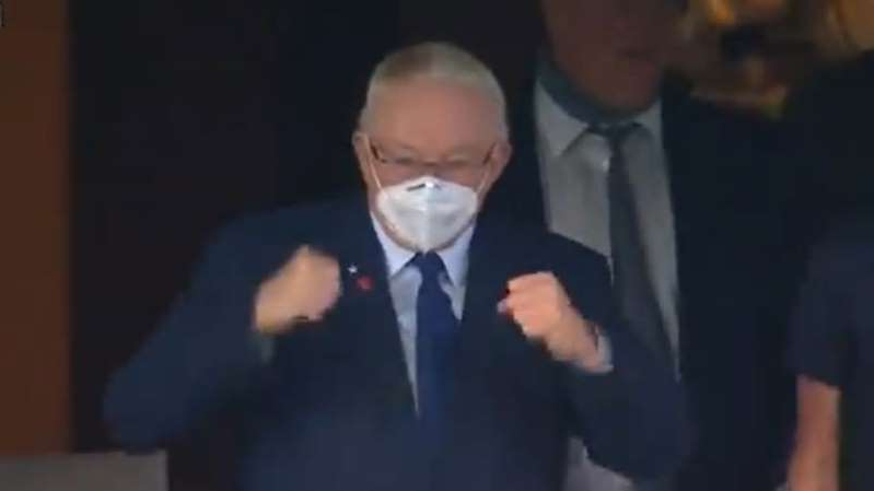 a man wearing a suit and tie: Jerry Jones was fired up after the Cowboys recovered an onside kick against the Falcons