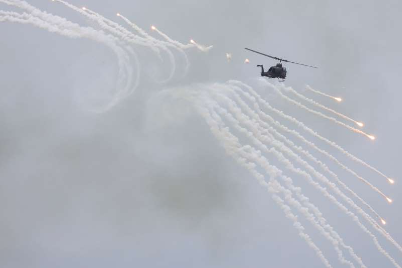 FILE PHOTO: An AH-1 Cobra helicopter fires during the live-fire, anti-landing Han Kuang military exercise, which simulates an enemy invasion, in Taichung