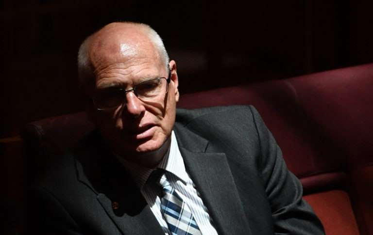 Jim Molan wearing a suit and tie