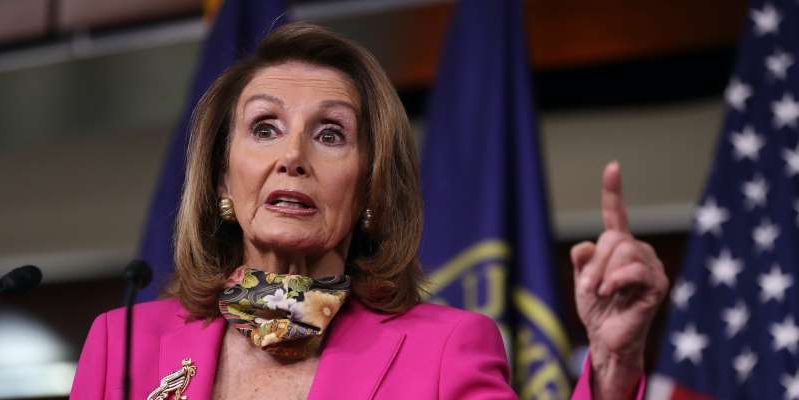 Nancy Pelosi wearing a pink shirt: Chip Somodevilla/Getty Images