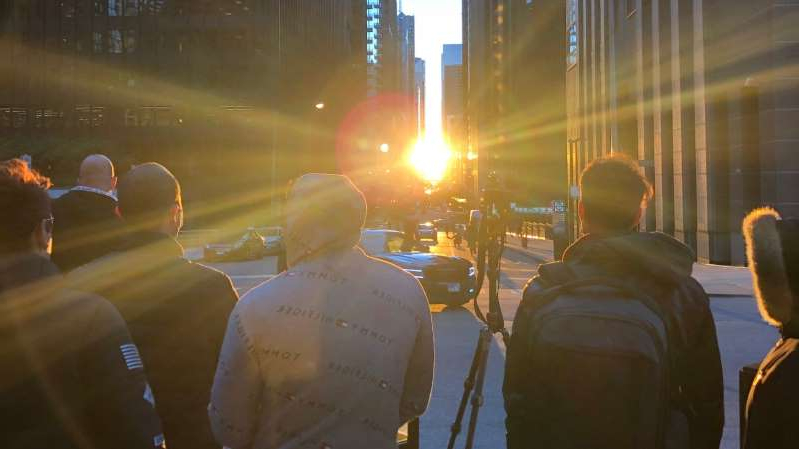 Photographers - professionals and amateurs - were seen all over downtown between 6 p.m. and 7 p.m. on Saturday to try and get the perfect shot of a rare phenomenon - the dramatic alignment of the setting sun and Chicago's