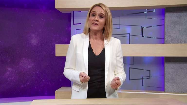 Samantha Bee standing in front of a box