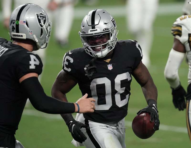 "a football player holding a bat: Now 2-0 on the season following their shocking win on ""Monday Night Football,"" these Raiders were the talk of the NFL world."