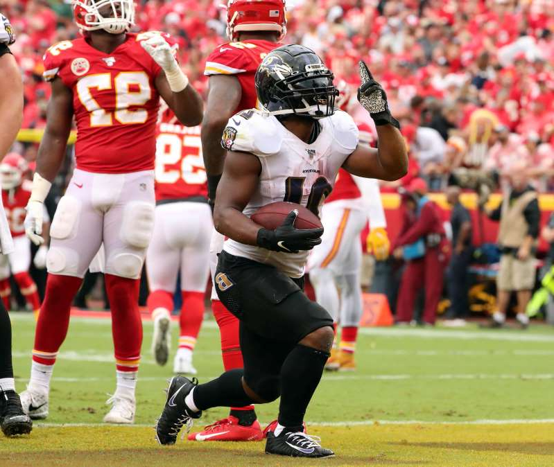 a group of baseball players playing a football game: RB Mark Ingram's (21) Ravens will try to knock off the reigning champion Chiefs on Monday night.
