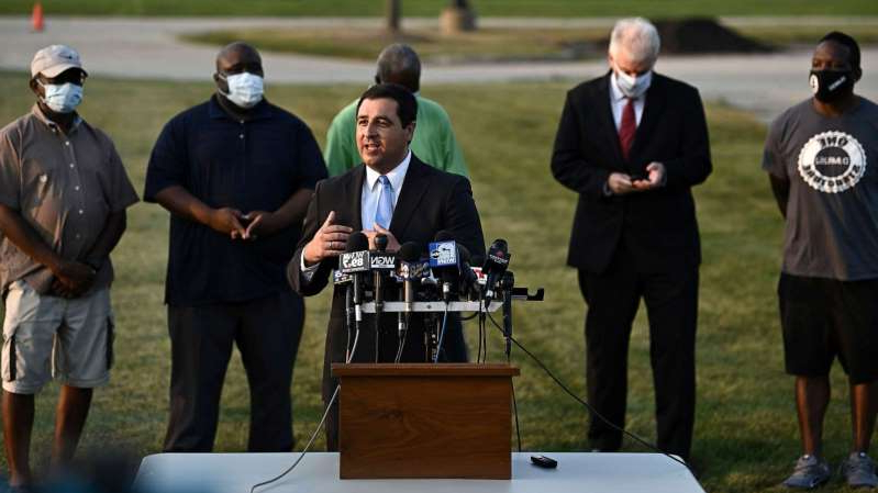 a group of people standing in the grass: Wisconsin Attorney General Josh Kaul speaks during a news conference following the police shooting of Jacob Blake, a Black man, in Kenosha, Wis., Aug. 26, 2020.