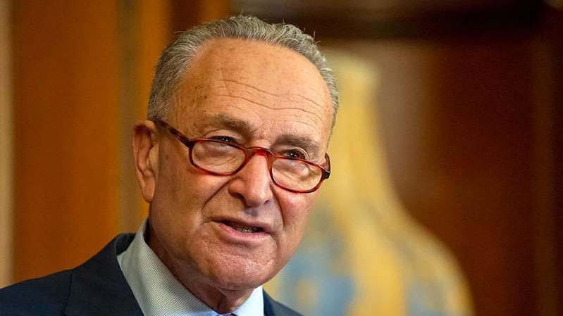 Chuck Schumer wearing glasses and looking at the camera: Democrats step up hardball tactics as Supreme Court fight heats up